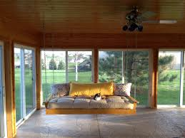 glorious sunroom furnishing ideas with wooden swing bed hang on