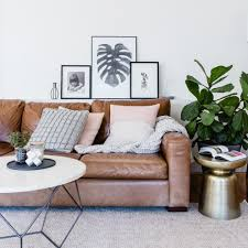 Leather Tufted Sofa by Magnificent Brown Leather Tufted Sofa With Coffee And Side Tables