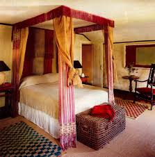 draped canopy beds atticmag draped canopy beds four poster canopy bed draped in antique asian textiles elle decor