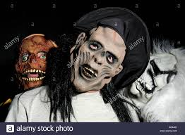 people wearing scary mask for halloween stock photo royalty free