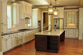 love the white and dark cabinets and the granite for the home