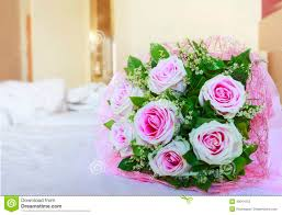 pink roses of valentine flowers bouquet on white bed with copy s