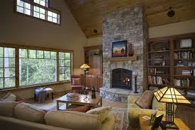 modern living room with stone fireplace green area rug green beige