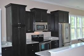 white kitchen cabinets with black countertops captainwalt com