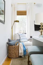 corner reading nook with white slipper chair and brass pharmacy