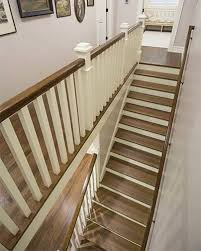 a new staircase and railing shows off quartersawn oak silent