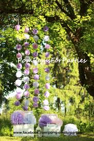 outside party hanging garland small size paper pom poms open air party