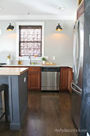 why painting our kitchen cabinets from thrifty decor chick gray cabinets kitchen