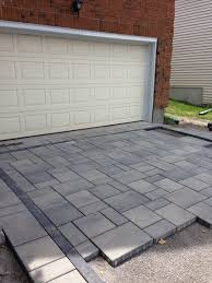 paver patio designs patterns interlock driveway in ottawa in the process of laying the pavers