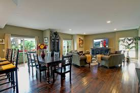 amazing painted green open floor plan kitchen and dining and