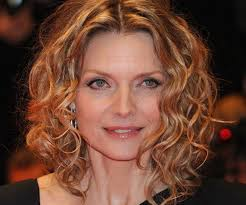 medium length curly hairstyles for women over 50 haircuts for