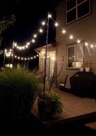 outdoor bulb string lights put removable posts on roof deck decoration diy outdoor lighting