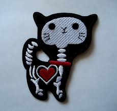 kitty skeleton and glowing heart