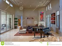 spacious living room with piano in foreground stock photo image