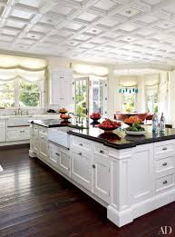 kitchen granite countertops with white cabinets cream backsplash