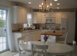kitchens shabby chic kitchen with white wall paneling also care