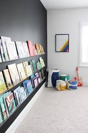 modern kids room kids room decor with black wall and book shelves book shelves