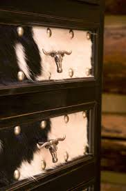 best 25 old western decor ideas on pinterest arrow decor 3 love the hide and handles do on front of old dresser in western bedroom