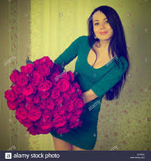 big bouquet of roses beautiful woman holding a big bouquet of roses stock photo