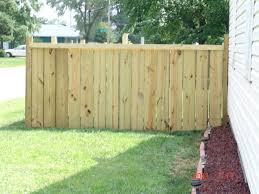building a privacy fence using 2x10s 2x4s 4x4s pressure treated