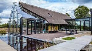 cottage meets greenhouse in modern thatched home villas modern