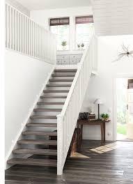 ek home interiors design helsinki trapprenovering i laminat mörk ek tillsammans med trappräcke