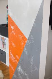 diy painted geometric wall made be a momma