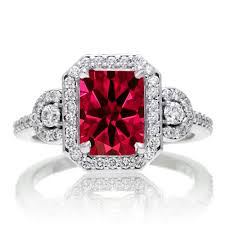 ruby engagement rings 2 carat emerald cut ruby and white halo engagement ring on