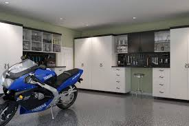 29 garage storage ideas plus 3 garage man caves a modern design is achieved in this garage of black and white melamine cabinets with full