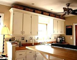 decorative items for above kitchen cabinets above kitchen cabinet ideas use decorative baskets or containers if