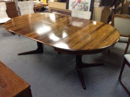 rosewood dining table and 4 chairs take it or leave it gorgeous rosewood round table with 4 rosewood chairs the chairs have just been reupholstered set includes 2 leaves stored under the table top