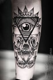 owl with eye pyramid tattoo on back leg photos pictures and