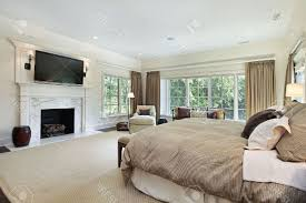 warm paint accent wall colors schemes cozy bedroom with fireplace