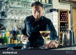 martini coffee bartender serving espresso martini layered cocktail stock photo