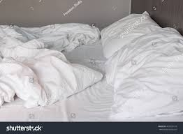 close white bedding sheets pillow messy stock photo 407330134