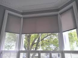 bathroom curvy window treatment ideas for creamy wall color