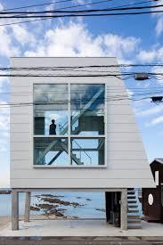 tiny narrow oceanfront cabin on stilts