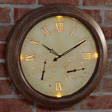 the 24 outdoor lighted atomic clock the only cordless illuminated outdoor clock hammacher schlemmer