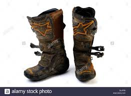 Well Worn Set Of Alpine Stars Motocross Dirt Bike Boots Stock