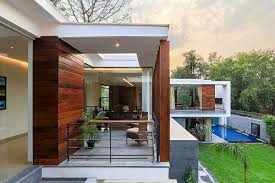 Stylish House Wooden Slats Glass Walls And Modern Grandeur Gallery House In India