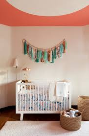 nautical crib bedding in nursery transitional with tassels next to