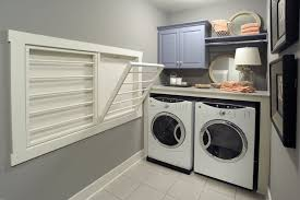 wall mounted cabinets for laundry room wall mounted clothes rack laundry room traditional with baseboards