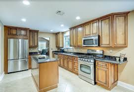 kitchen ideas with oak cabinets and stainless steel appliances light wood kitchen cabinets with stainless steel appliances