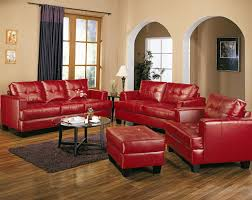 red leather love seat combined with round glass top coffee table