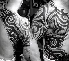 big black and white tribal tattoo with samurai mask tattoo on
