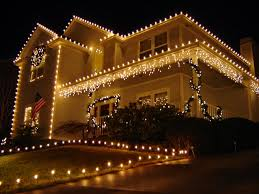 outdoor christmas garland with lights lighted roof line and path combined white garland lights on the wall