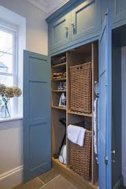 Laundry Room Detergent Storage by Utility Cupboard With Space For Ironing Board U0026 Hoover With