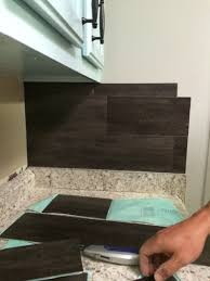 vinyl kitchen backsplash our 40 backsplash using vinyl flooring kitchens house and