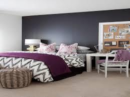 dark purple bedroom walls chrome bedside tables bright brown wood