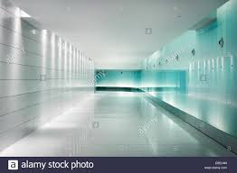 back lighted white glass walls in an underground metro station